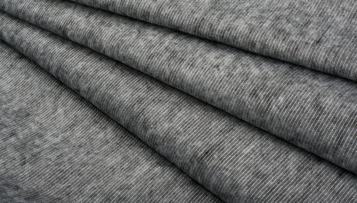 Флизелин — полусинтетический бумагоподобный нетканый материал на основе проклеенных и непроклеенных целлюлозных волокон